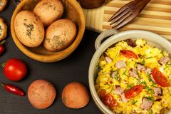 Scrambled eggs with herbs, simple, full protein breakfast with fresh herbs. Bio eggs from domestic breeding. Healthy food. Royalty Free Stock Image