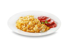 Scrambled eggs with herbs and tomato Royalty Free Stock Images