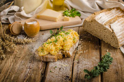 Scrambled eggs on homemade bread Stock Photography
