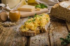 Scrambled eggs on homemade bread Stock Image