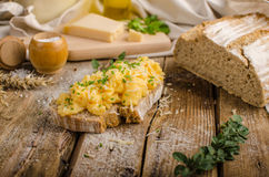 Scrambled eggs on homemade bread Stock Images