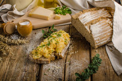 Scrambled eggs on homemade bread Royalty Free Stock Photo