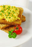 Scrambled eggs ith chopped chives on toast Royalty Free Stock Images