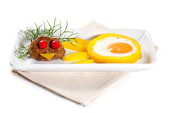 Scrambled eggs with meat on plate Royalty Free Stock Photo