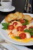 Scrambled eggs with mozzarella Stock Image