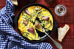 Scrambled eggs with mushrooms and onions in a pan Royalty Free Stock Image
