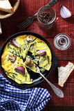 Scrambled eggs with mushrooms in a pan Stock Images
