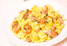 Scrambled eggs with mushrooms stock photography
