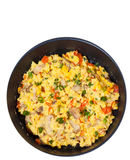 Scrambled eggs with mushrooms and vegetables in a frying pan. top view. isolated Royalty Free Stock Photo