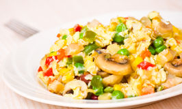 Scrambled eggs with mushrooms and vegetables Royalty Free Stock Photography