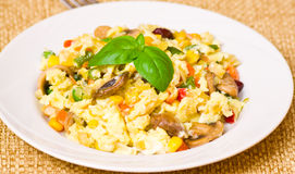 Scrambled eggs with mushrooms and vegetables Stock Photo