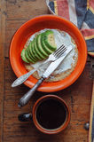 Scrambled eggs with oatmeal, cheese and avocado. Breakfast with coffee, eggs, avocado and  cream cheese Royalty Free Stock Photography