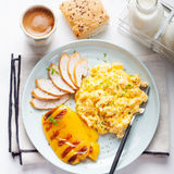 Scrambled eggs, omelet, sweet pepper and hot smocked chicken, ham. Royalty Free Stock Images