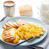 Scrambled eggs, omelet, sweet pepper and hot smocked chicken, ham. Stock Photo