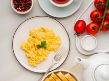 Scrambled eggs, Omelette. Breakfast with pan-fried eggs, cup of royalty free stock photo