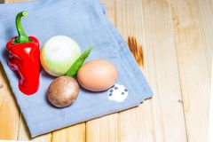 Scrambled eggs omelette ingredients raw red pepper onion champig royalty free stock photos