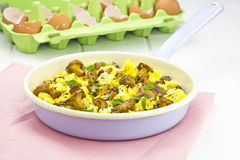 Scrambled eggs on pan Stock Photos
