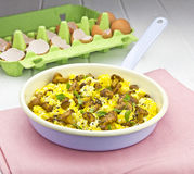 Scrambled eggs on pan Royalty Free Stock Images