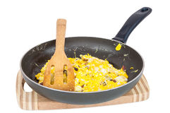 Scrambled eggs in a pan Stock Images