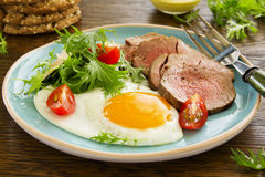 Scrambled eggs with roast beef Stock Images