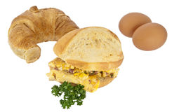 Scrambled eggs on a roll with croissant Stock Photo