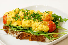 Scrambled eggs on rye bread Stock Image