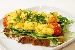 Scrambled eggs on rye bread Stock Image