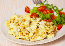 Scrambled eggs with salad Royalty Free Stock Images