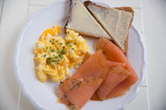 Scrambled eggs with salmon Stock Image