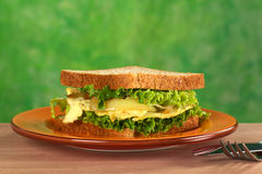 Scrambled Eggs Sandwich. With fried onions and lettuce (Selective Focus, Focus on the front of the sandwich Stock Photography