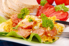 Scrambled eggs with sausage. And parsley for breakfast Stock Images