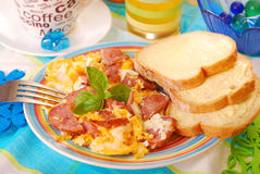 Scrambled eggs with sausage Royalty Free Stock Photography