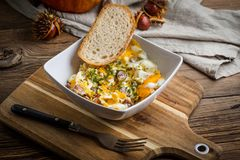 Scrambled eggs with sausage and bread. Tasty breakfast - scrambled eggs with sausage and bread Royalty Free Stock Photos