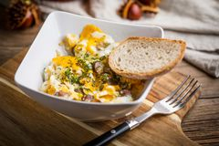 Scrambled eggs with sausage and bread. Tasty breakfast - scrambled eggs with sausage and bread Royalty Free Stock Images