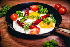 Scrambled eggs with sausage delicious breakfast Royalty Free Stock Images