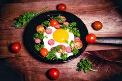 Scrambled eggs with sausage delicious breakfast Royalty Free Stock Image