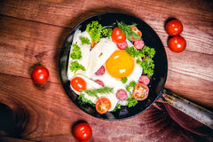 Scrambled eggs with sausage delicious breakfast Royalty Free Stock Photography