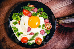 Scrambled eggs with sausage delicious breakfast Stock Photography
