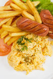 Scrambled eggs, sausage and french fries Royalty Free Stock Photo