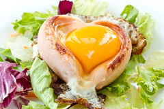 Scrambled eggs with sausage in a heart Stock Image