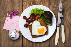 Scrambled eggs with sausage in a heart shape Royalty Free Stock Image
