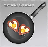 Scrambled eggs with sausage in a heart shape in the pan. Royalty Free Stock Image