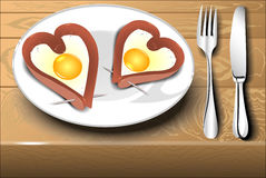 Scrambled eggs with sausage in a heart shape Stock Photo