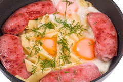 Scrambled eggs and sausage with pasta Royalty Free Stock Photography