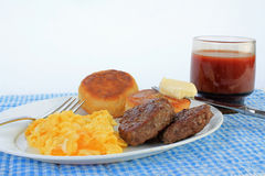 Scrambled Eggs and Sausage Patties Stock Photos