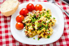 Scrambled eggs with sausage. Tasty breakfast - scrambled eggs with sausage, black coffee and bread with butter Royalty Free Stock Photo