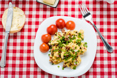 Scrambled eggs with sausage. Tasty breakfast - scrambled eggs with sausage, black coffee and bread with butter Stock Images