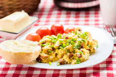 Scrambled eggs with sausage Stock Photos