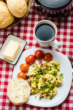 Scrambled eggs with sausage. Tasty breakfast - scrambled eggs with sausage, black coffee and bread with butter Royalty Free Stock Photos