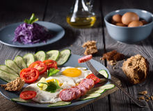 Scrambled eggs and sausage with vegetables Stock Photo